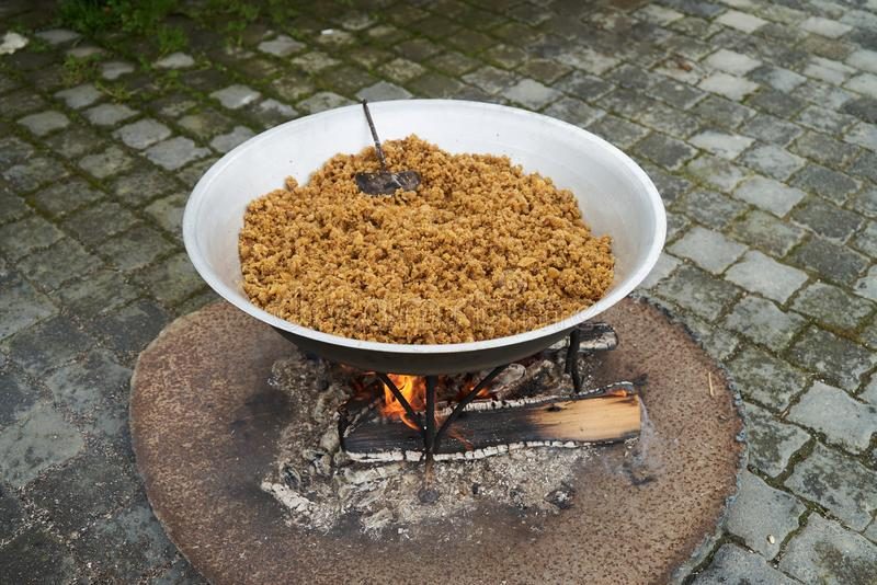Traditional Azerbaijan food halwa cooking on bonfire, outdoors. Close-up stock photos