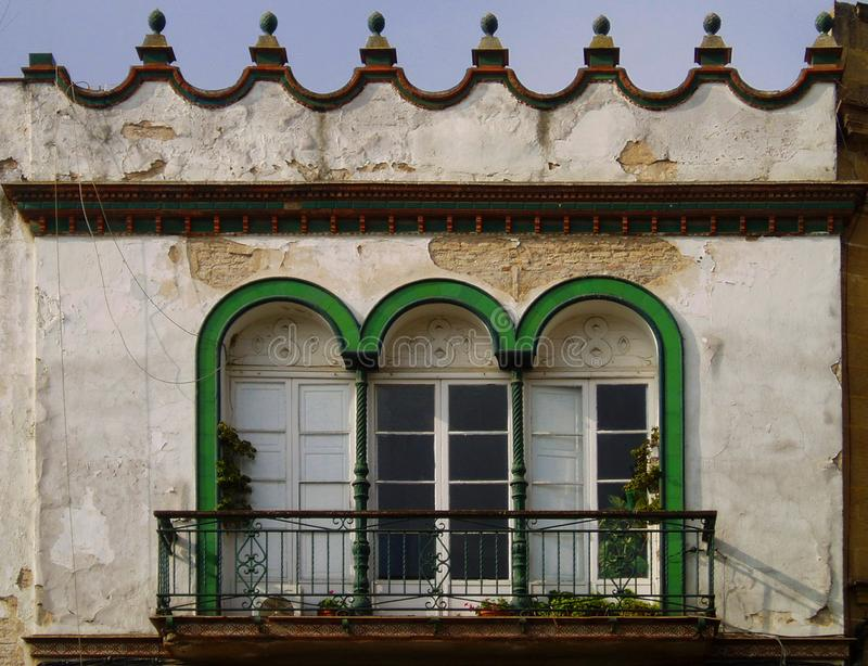 House in Jerez de la Frontera. Spain. Traditional balcony with three arches in the city of Jerez de la Frontera. Andalusia. Spain stock image
