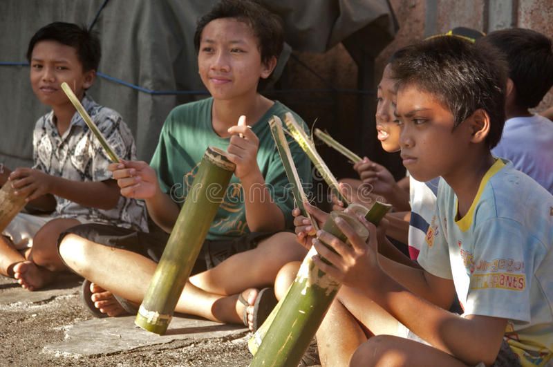 Traditional Balinese music instrument (kulkul). A group of children were playing traditional musical instrument made of bamboo with a club on the stock image