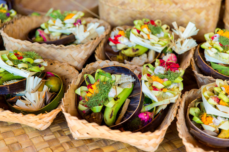 Traditional balinese offerings to gods in Bali with flowers and royalty free stock photo
