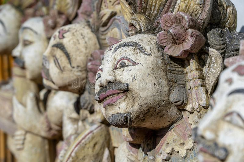 Traditional Balinese stone statue of the deity in the street temple. Island Bali, Indonesia . Closeup stock photography