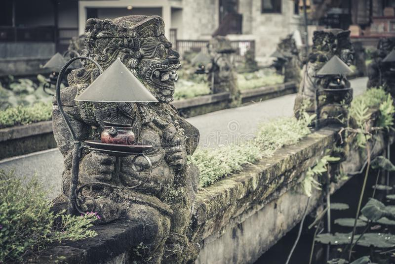 Traditional balinese stone statue stock image