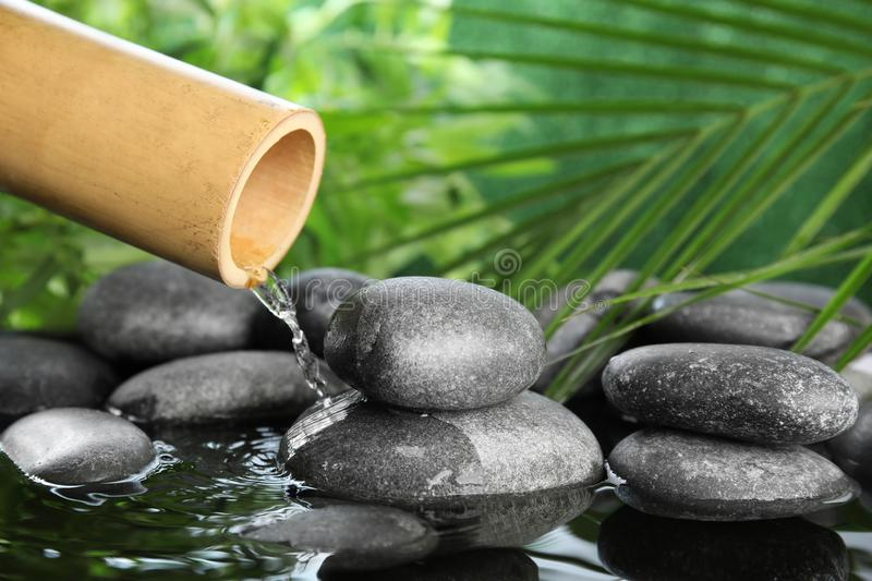 Traditional bamboo fountain with zen stones royalty free stock image