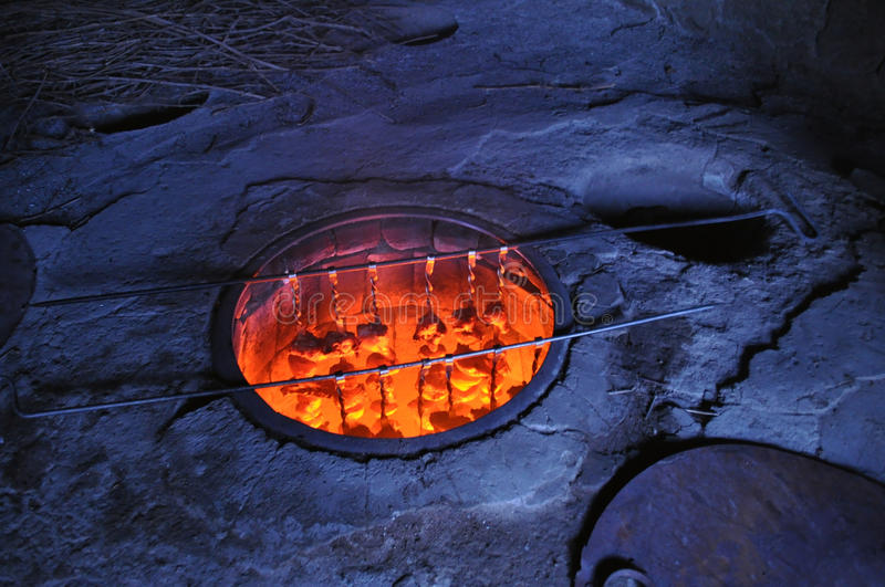 Traditional barbecue in Armenia. xorovac. In tandoor oven stock photography