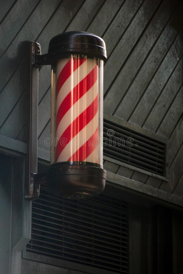 Traditional barber shop sign post royalty free stock photography
