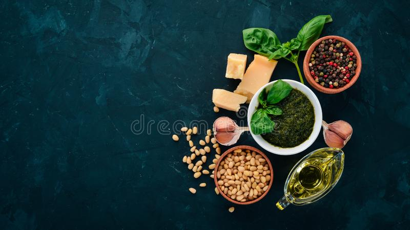Traditional basil pesto sauce. Basil, parmesan cheese, olive oil, pine nuts, pepper, garlic. royalty free stock images