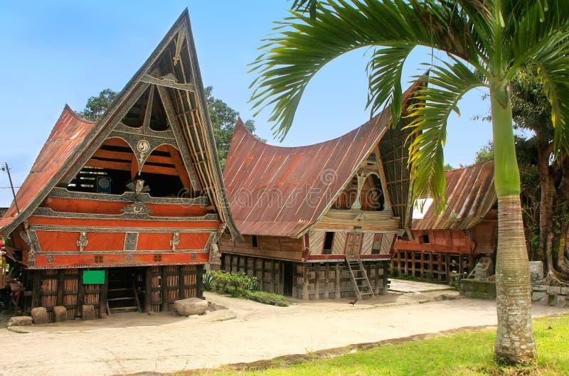 Traditional Batak houses on Samosir island, Sumatra, Indonesia. Southeast Asia royalty free stock photo
