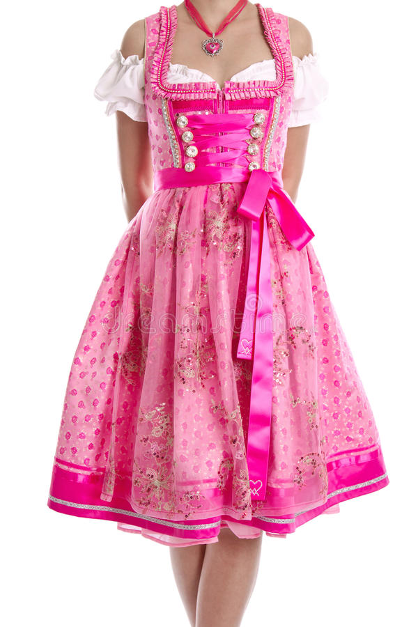 Traditional bavarian dress called. Dirndl isolated on white and in pink color royalty free stock photos