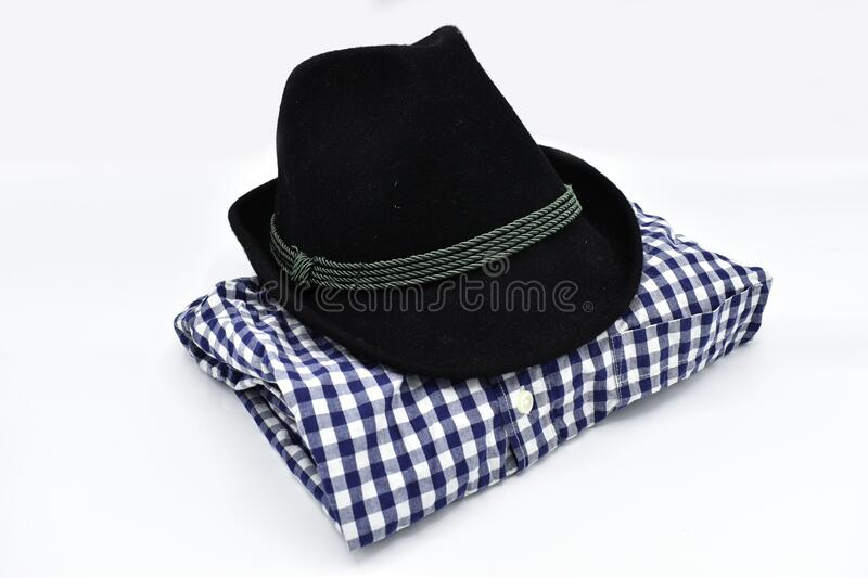Traditional bavarian mens Oktoberfest clothing shirt and hat isolated on white background stock photography