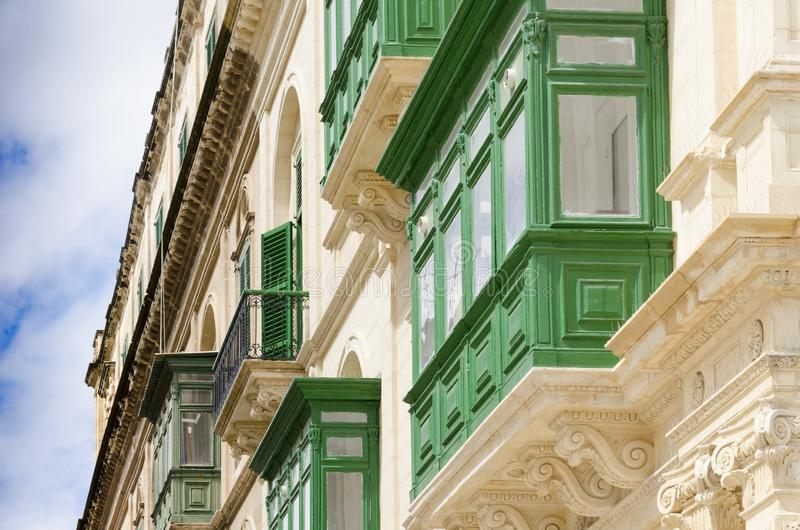 Traditional bay windows, Malta. A building with green bay balconies in historical part of Valetta on Malta royalty free stock image