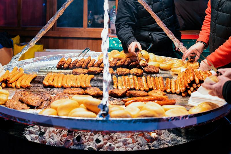Traditional BBQ barbeque wurst sausages on Christmas market Berlin. Traditional BBQ barbeque wurst sausages on Christmas market in Germany in Europe in winter royalty free stock images
