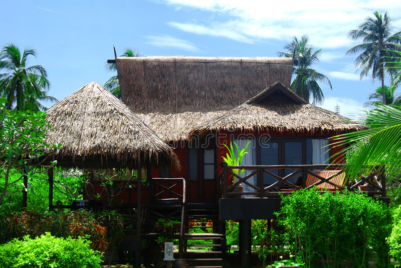 Traditional beach bungalow stock images