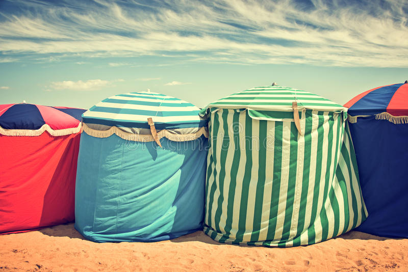 Traditional beach umbrellas in Deauville. Vintage process stock image