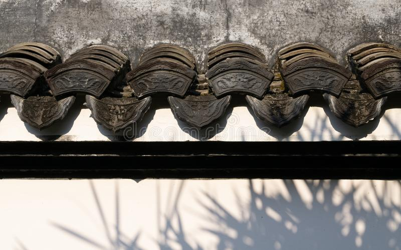 Traditional beautiful ancient chinese textured on the wall of Chinese building in the garden stock photo