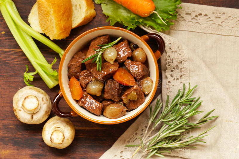 Traditional beef goulash - Boeuf bourguigno. Comfort food. Stew meat with vegetables royalty free stock images