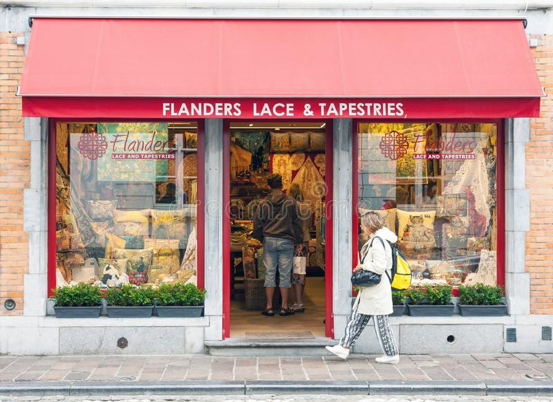 Traditional Belgian handmade lace and tapestries shop in Brugge. Brugge, Belgium - 27 August, 2018: Traditional Belgian handmade lace and tapestries shop stock images