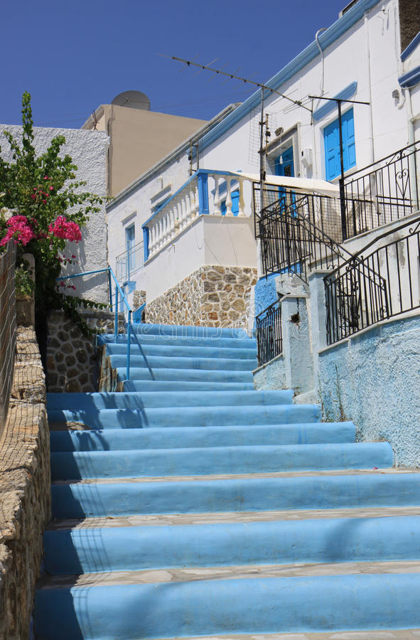 Traditional Blue And White Greek Steps With Flowers Stock