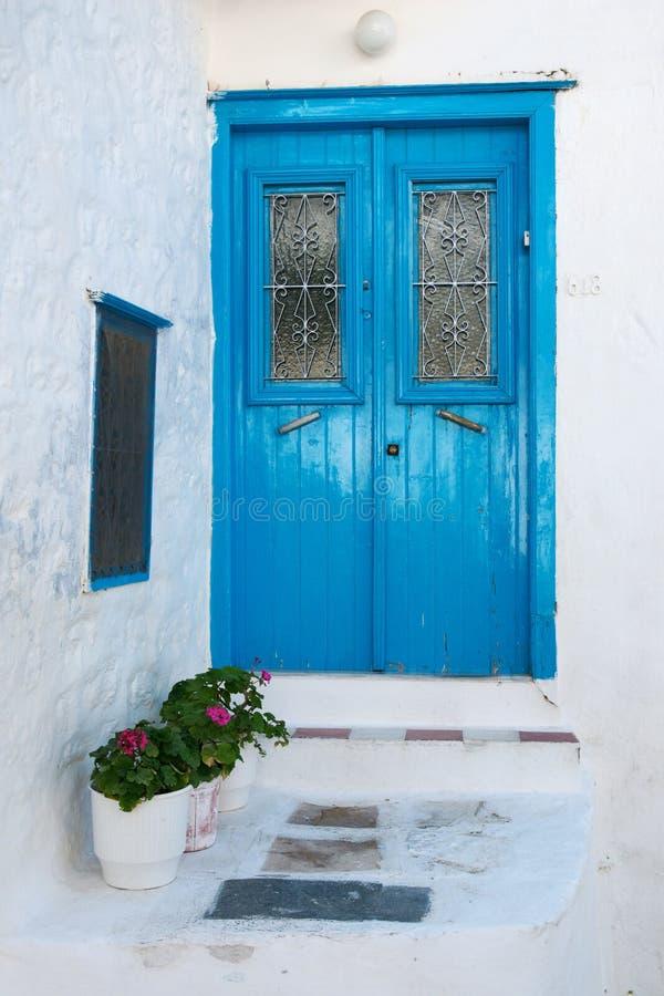 Traditional blue wooden door, Greece stock photos