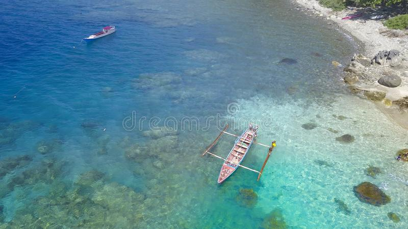Traditional boat with Beautiful nature of blue sea sand and Turquoise color water waves stock images