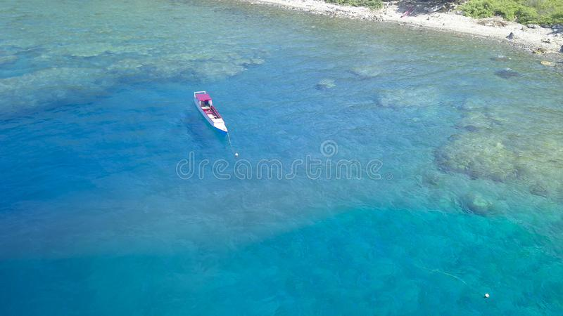 Traditional boat with Beautiful nature of blue sea sand and Turquoise color water waves royalty free stock photos