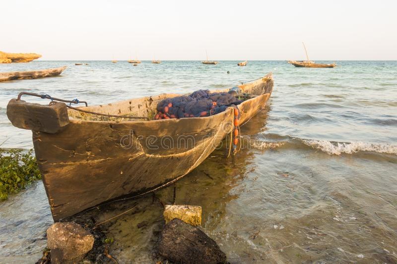 Old traditional fishermen`s boat Kenyan beach. A traditional boat made with ancestral craftmanship by the local Kenyan fishermen of the coast of the Indian Ocean royalty free stock photo