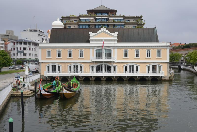 Traditional boat, Moliceiro, built to transport tourists at a canal basin in Aveiro, Portugal stock image