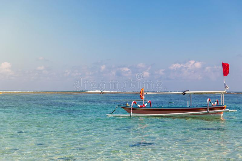 Traditional boat and tropical seascape at Pandawa beach photo stock