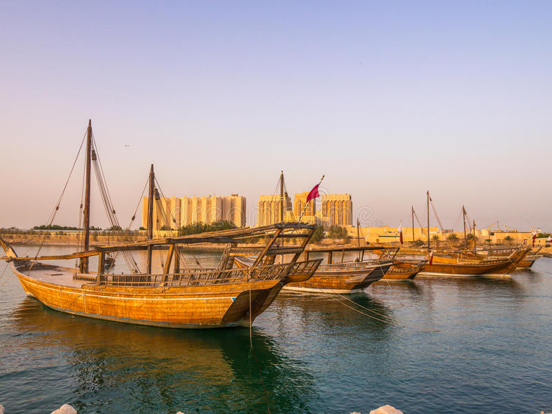 Traditional boats called Dhows are anchored in the port. Near Museum of Islamic Art Park in Doha, Qatar royalty free stock photo
