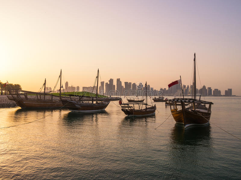 Traditional boats called Dhows are anchored in the port. Near Museum of Islamic Art Park in Doha, Qatar stock photography