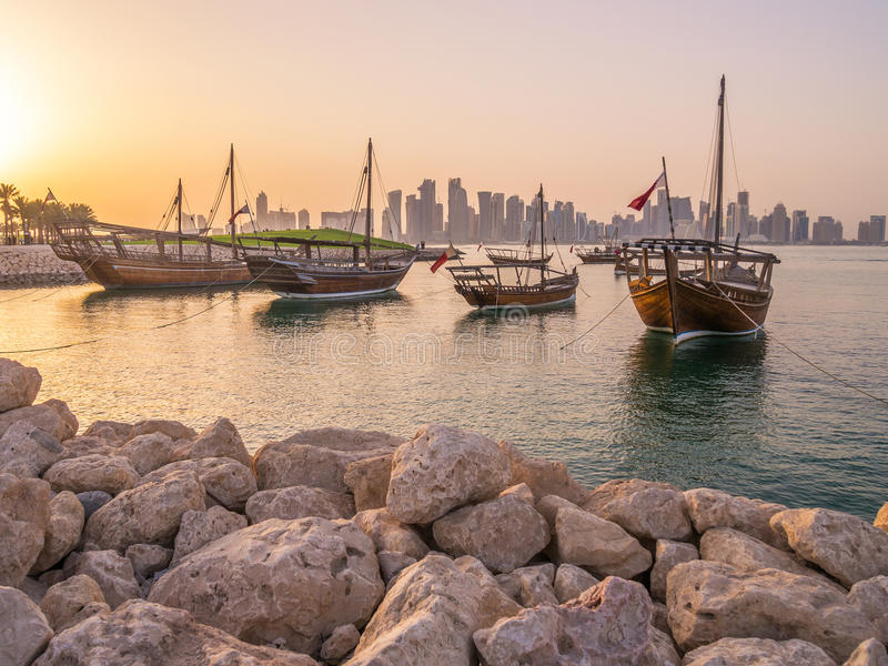 Traditional boats called Dhows are anchored in the port. Near Museum of Islamic Art Park in Doha, Qatar royalty free stock photography