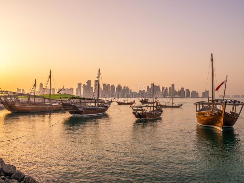 Traditional boats called Dhows are anchored in the port. Near Museum of Islamic Art Park in Doha, Qatar stock photos