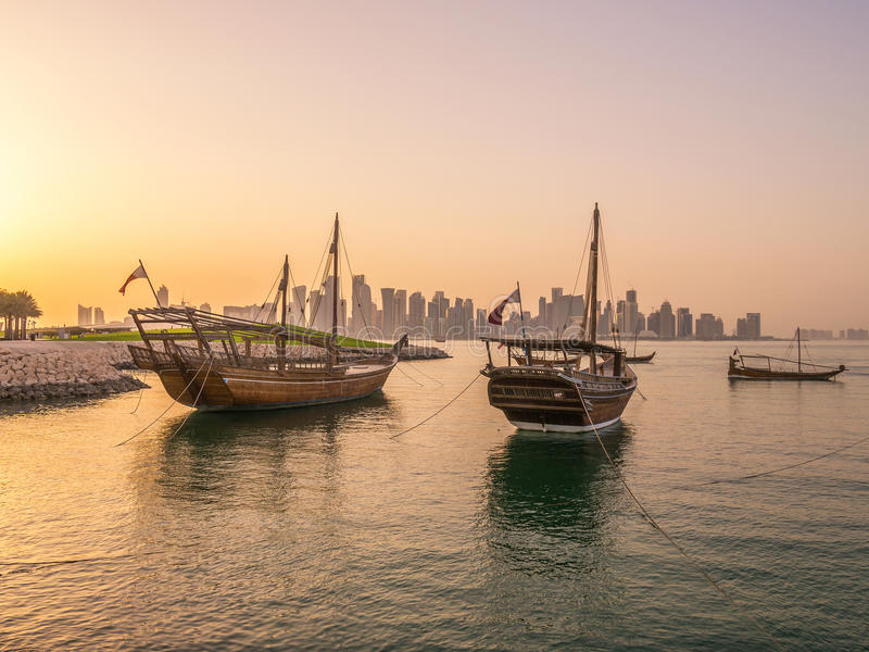 Traditional boats called Dhows are anchored in the port. Near Museum of Islamic Art Park in Doha, Qatar stock images