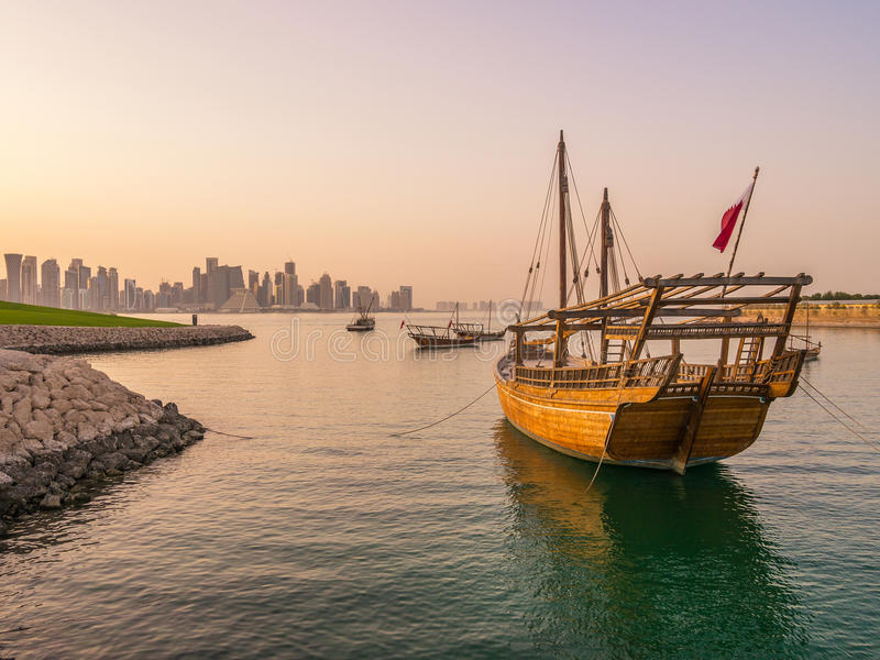 Traditional boats called Dhows are anchored in the port. Near Museum of Islamic Art Park in Doha, Qatar stock photo