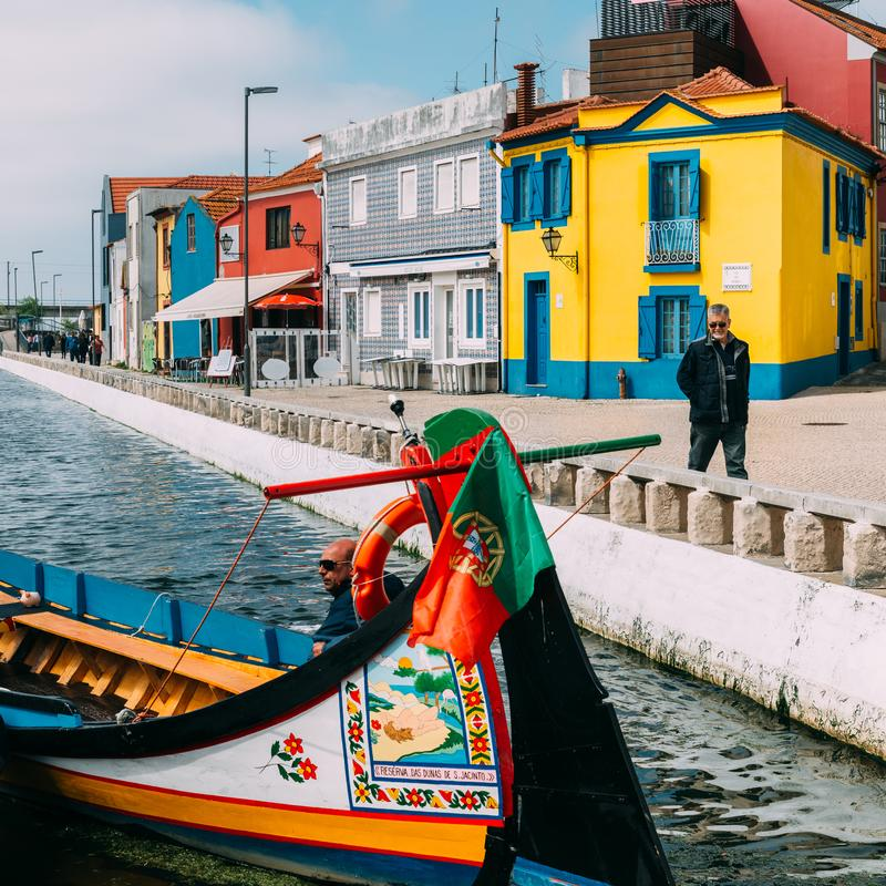 Traditional boats on the canal in Aveiro, Portugal. Colorful Moliceiro boat rides in Aveiro are popular with tourists to royalty free stock photography