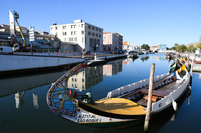 Traditional boats on the canal in Aveiro. Typical Moliceiro boats in Vouga river. Early morning. Aveiro, Northwest of Portugal royalty free stock photo