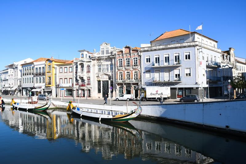 Traditional boats on the canal in Aveiro. Typical Moliceiro boats in Vouga river. Early morning. Aveiro, Northwest of Portugal stock images