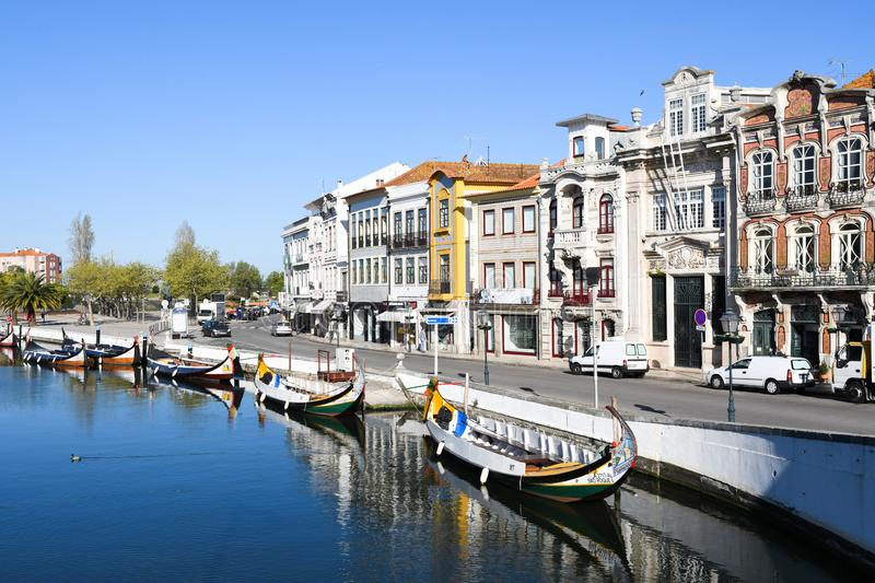 Traditional boats on the canal in Aveiro. Typical Moliceiro boats in Vouga river. Early morning. Aveiro, Northwest of Portugal royalty free stock photography