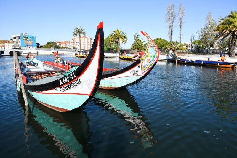 Traditional boats on the canal in Aveiro. Typical Moliceiro boats in Vouga river. Early morning. Aveiro, Northwest of Portugal stock photography