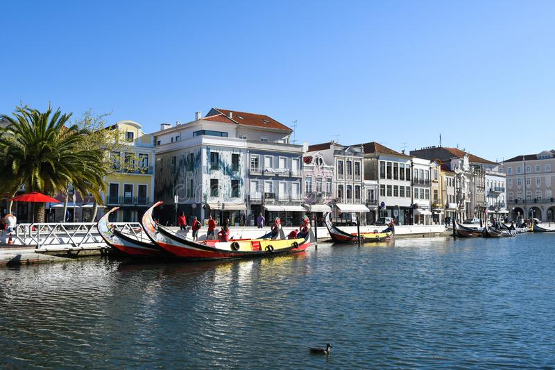 Traditional boats on the canal in Aveiro. Typical Moliceiro boats in Vouga river. Aveiro, Northwest of Portugal royalty free stock photos