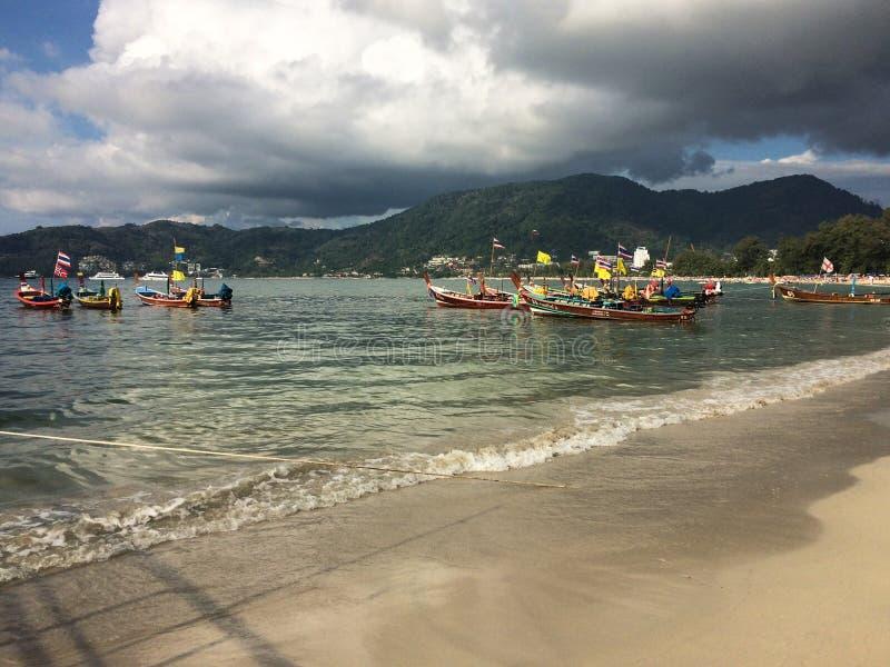 Traditional boats on coastline, Thailand stock image