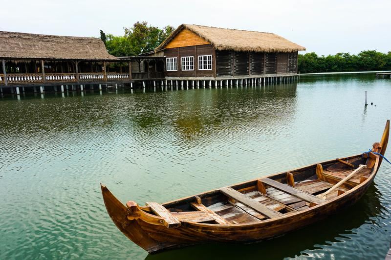 Traditional boats are leaning on a quiet dock. It`s boardwalk type dock royalty free stock photography