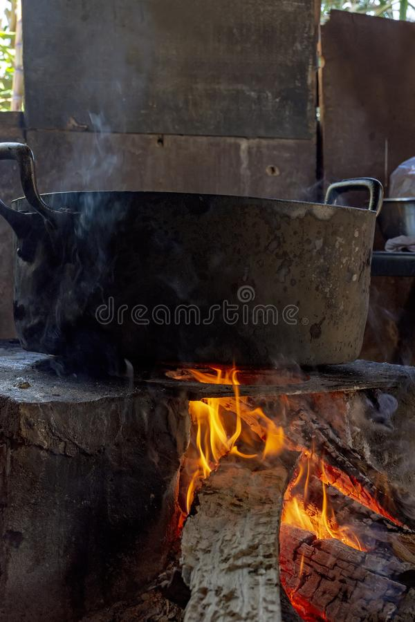 Traditional Brazilian food being prepared on old and popular wood stove. Traditional food being prepared on old and popular wood stove royalty free stock images