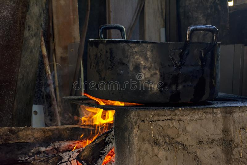 Traditional Brazilian food being prepared on old and popular wood stove. Traditional food being prepared on old and popular wood stove stock photos