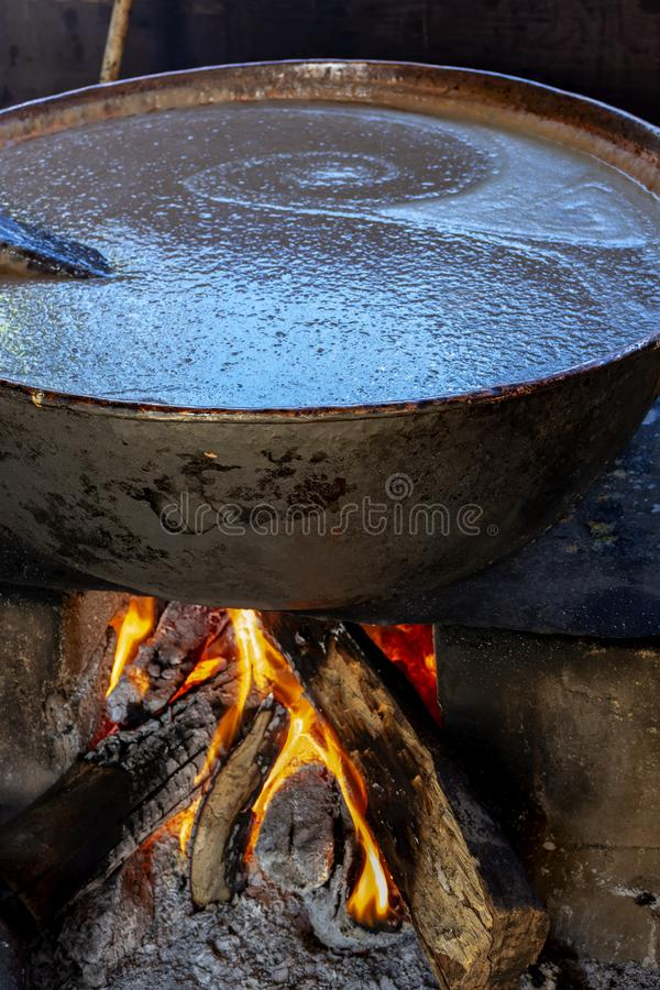 Traditional Brazilian food being prepared on old and popular wood stove. Preparing beans royalty free stock images