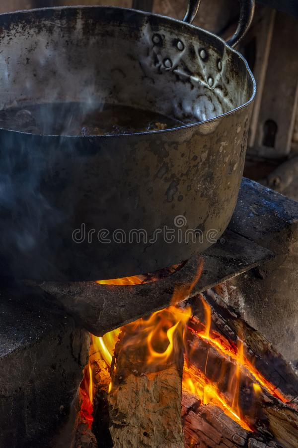 Traditional Brazilian food being prepared on old and popular wood stove. Traditional Brazilian food being prepared on old popular wood stove royalty free stock image