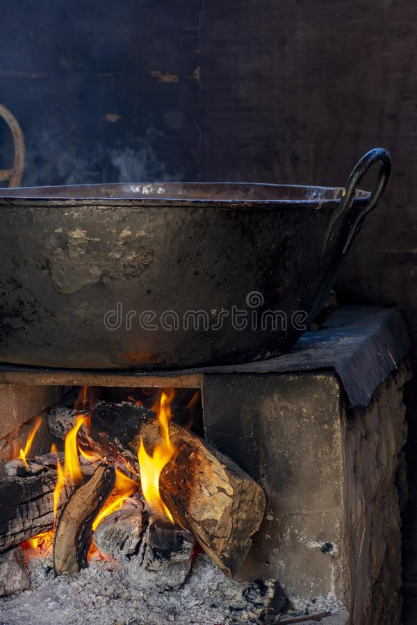 Traditional Brazilian food being prepared on old and popular wood stove. Traditional Brazilian food being prepared on old and wood stove royalty free stock photography
