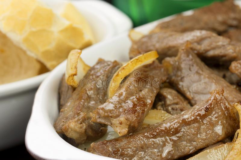Traditional Brazilian pub food striploin with onions close stock photography