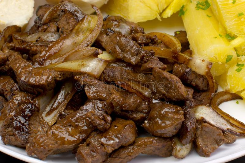 Traditional Brazilian pub food striploin with onions. 1 stock images