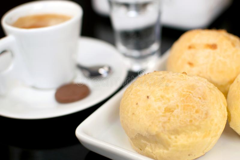 Traditional Brazilian snack cheese bread in a bistro table with a cup of coffee stock photos