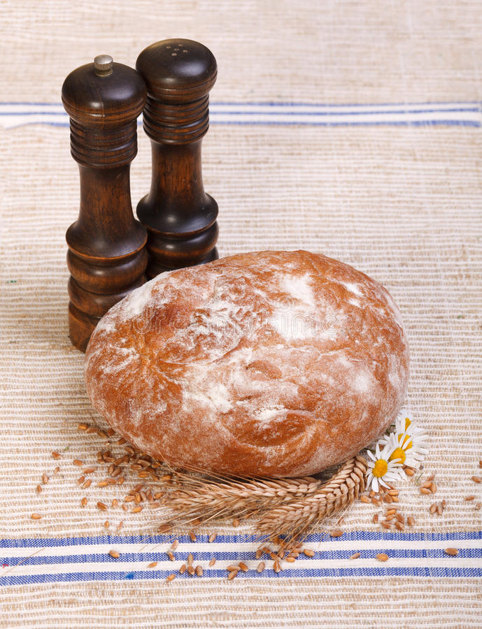 Download Traditional Bread With Salt And Pepper Shaker Royalty Free Stock Image - Image: 26119006